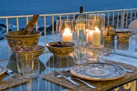 Candle lit dinner on the terrace with a view of the sea.