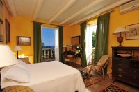 21/66 A bedroom with views towards the sea and Mt Etna.