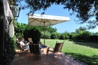 49/66 The lovely terrace and lawn at Casa all'Olmo.