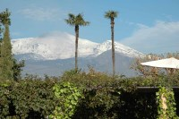 53/66 A snow covered Etna seen from the pool at the beginning of April.