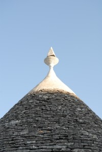 A typical trullo with its conical limestone-tiled roof.