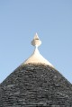 9/38 A typical trullo with its conical limestone-tiled roof.