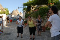 38/43 Local ladies welcoming visitors to Alberobello with a song.