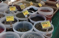 Capers, olives and various pickles at the market in Monopoli.