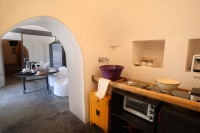 17/43 The bathroom and kitchen are in the same conical trullo.