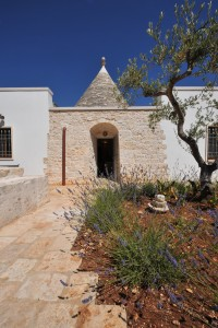 Approaching one of the trulli through the fragrant gardens.
