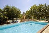 The raised pool and Trullo Selva behind (the pool furniture has been renewed).