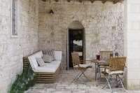 Relaxing area outside the kitchen of Trullo Bianco.