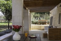 Relaxing and dining area behind Trullo Pietra with barbecue.