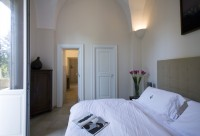 13/42 The second bedroom in the larger villa, looking through to...