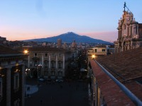Twilight in Catania with Mount Etna in the background.