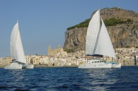 Discovering the coast around Cefalù by catamaran...