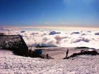 Skiing above the clouds on Mount Etna.