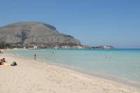 The pristine sandy beach and transparent waters of Mondello in May.