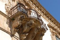 Intricate and imaginative detailing on a balcony in Scicli.
