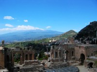 47/49 The Teatro Greco in Taormina with the stunning backdrop of Mount Etna.