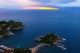 29/41 Dawn over Isola Bella and Taormina.