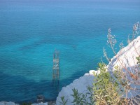 The cobalt waters of the pumice stone sea quarries in Lipari.