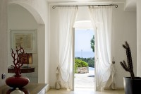 15/47 French windows lead out onto the shaded terraces overlooking the pool and the sea.