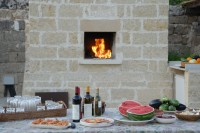 ...with BBQ and wood-burning oven perfect for baking pizzas.