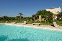 1/60 The pool and the imposing Masseria behind.