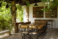 A shady spot for al fresco dining close to the kitchen and living room.